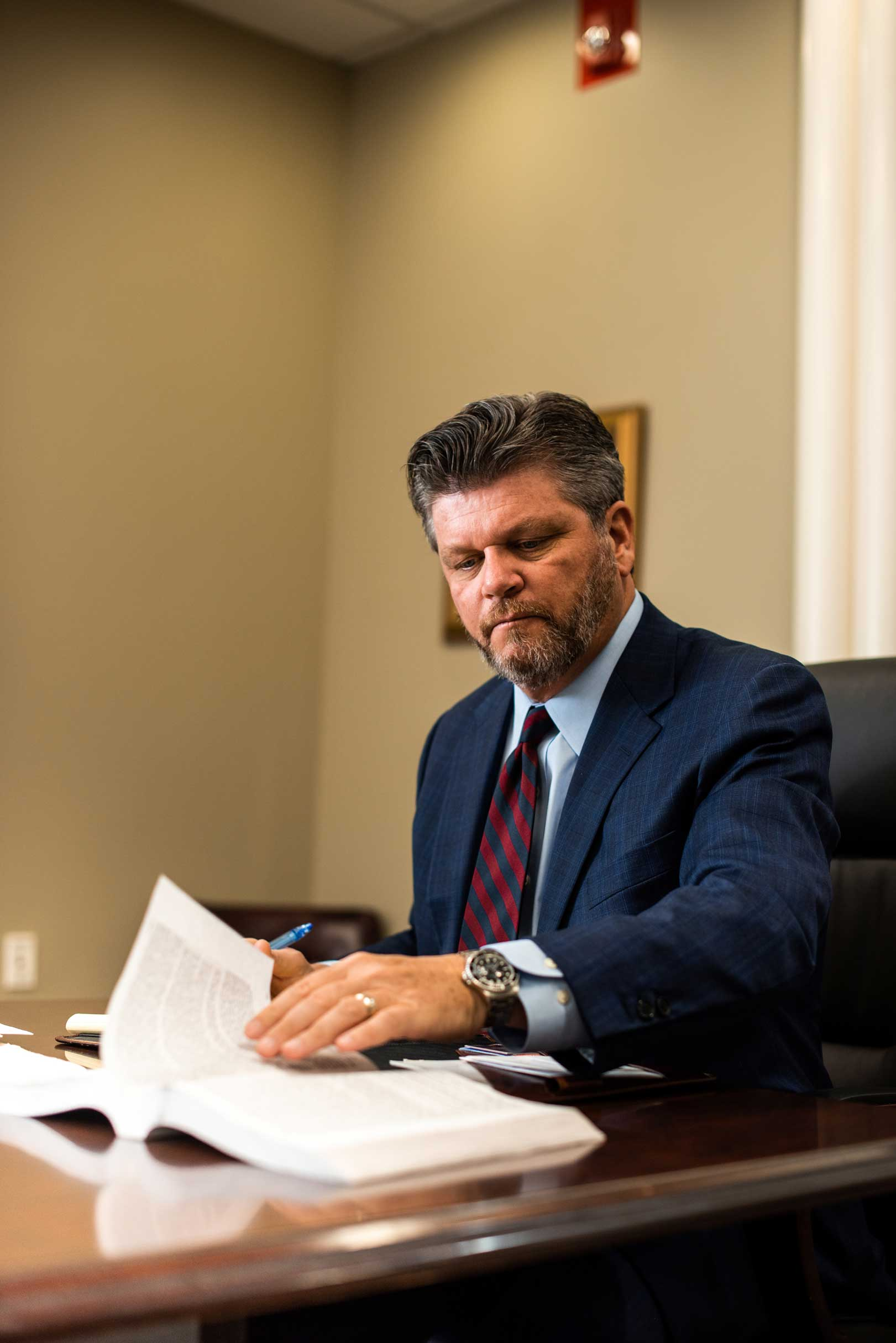John Harralson looking over some documents in the conference room
